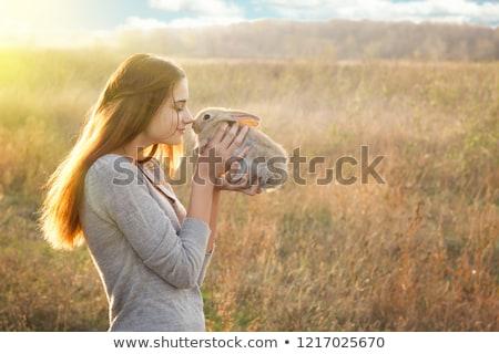 fiatal · lány · tart · dekoratív · nyuszi · fiatal · hölgy - stock fotó © chesterf