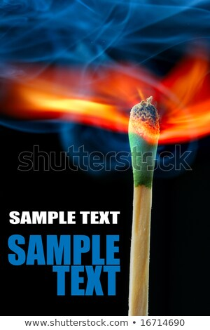 Burning match over dark background and space for text Stock photo © Elmiko