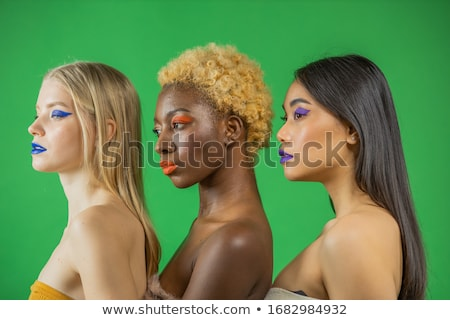 Young woman standing and smiling with many different people's fa Stock photo © HASLOO