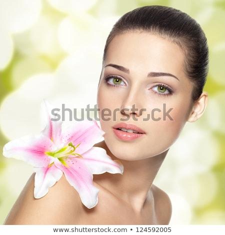 jovem · beleza · flor · água · mãos - foto stock © hasloo