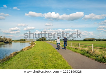 Two bikes on a dike in the Netherlands Stock photo © Hofmeester