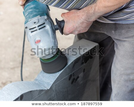 work with polished granite grinder Stock photo © OleksandrO