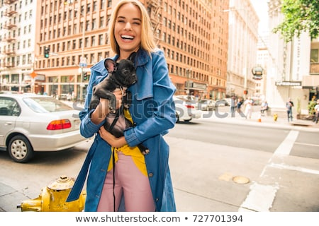Vogue. Beautiful blonde with dog Stock photo © racoolstudio
