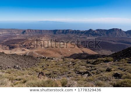 vrouw · boogschutter · storm · rotsen · natuur · wereld - stockfoto © alexeys
