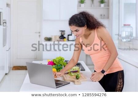 nő · laptopot · használ · főzés · fiatal · nő · ház · internet - stock fotó © imagedb