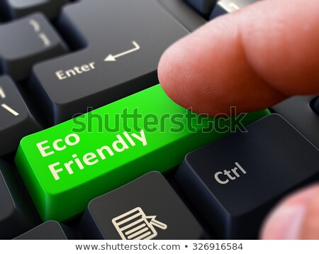 Pressing Green Button Eco Friendly on Black Keyboard. Stock photo © tashatuvango