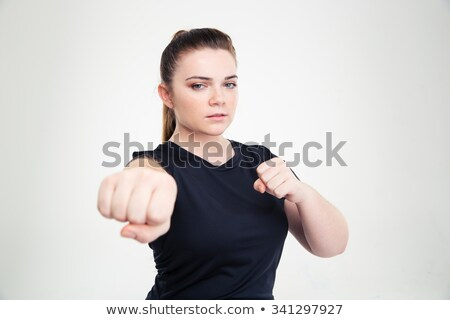 Fat woman in sports wear hitting at camera  Stock photo © deandrobot