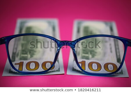 dollars by the closeup through the eyeglasses stock photo © Paha_L