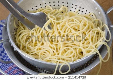 Spaghetti in sieve Stock photo © Digifoodstock