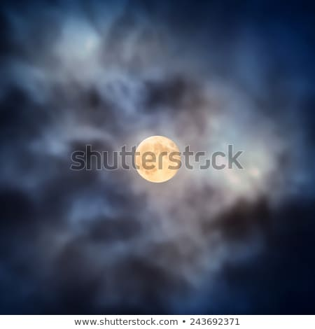 Night view at the full moon through moving clouds Stock photo © vapi