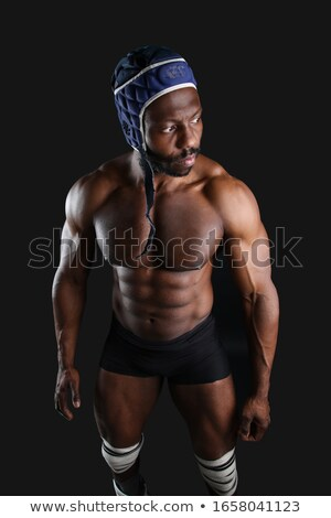Muscular african man athlete standing and practicing shadow boxing outdoors Stock photo © deandrobot