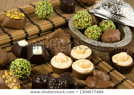 row of almonds on a wooden base Stock photo © faustalavagna