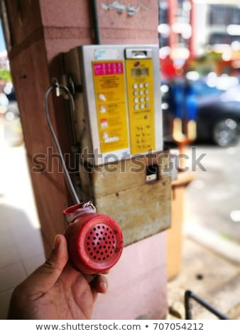 Demolished and vandalized public phone booth on street Stock photo © stevanovicigor