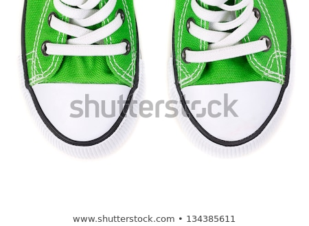 White sneaker with green laces on white background Stock photo © janssenkruseproducti