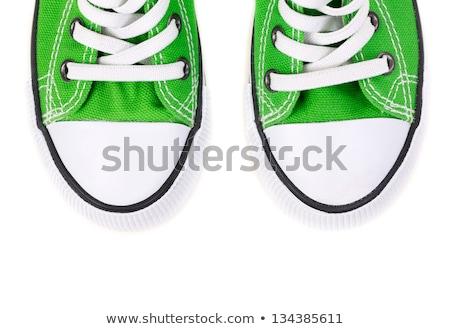 White sneaker with green laces on white background stock photo © janssenkruseproducti