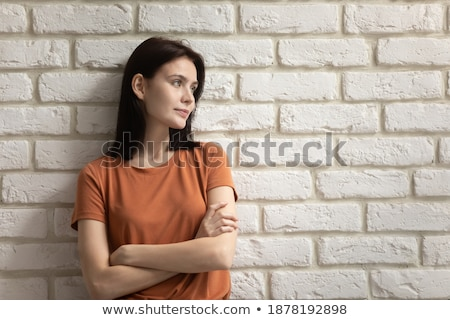Serene Woman Standing near Wall Stock photo © dariazu