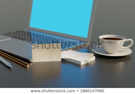 Businesscard with laptop and papers in background Stock photo © bluering