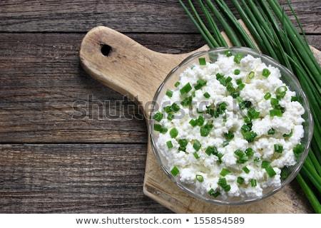 Fresche formaggio erba cipollina aglio legno tagliere Foto d'archivio © Digifoodstock