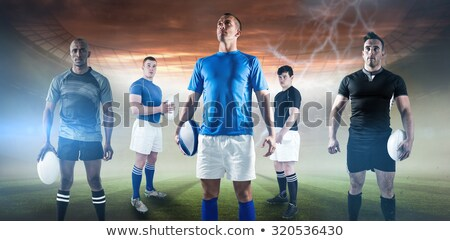 Rugby player holding ball while standing against goal post  Stock photo © wavebreak_media