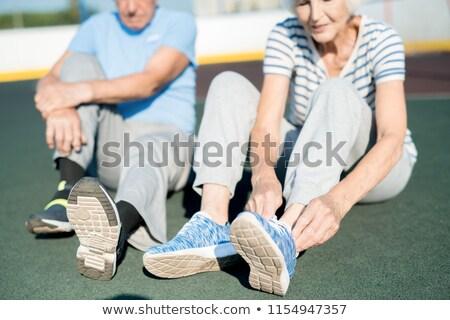 Mid section of woman wearing sport shoes Stock photo © wavebreak_media
