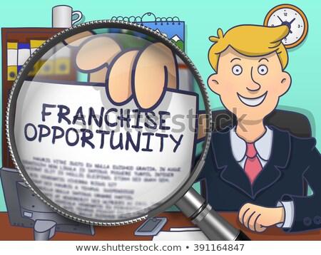 Franchise Opportunity through Magnifying Glass. Doodle Style. Stock photo © tashatuvango