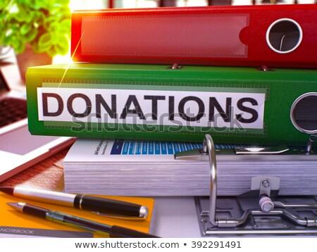 green ring binder with inscription donations stock photo © tashatuvango