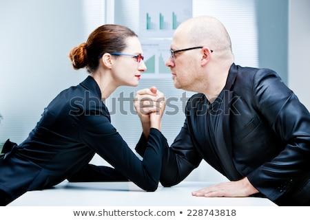 Homme vs femme confrontation concurrence sexe Photo stock © studiostoks