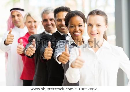 Young muslim man giving thumb up. Stock photo © RAStudio