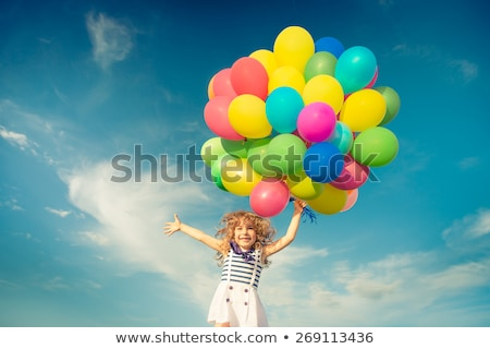 child with colorful balloons Stock photo © LightFieldStudios