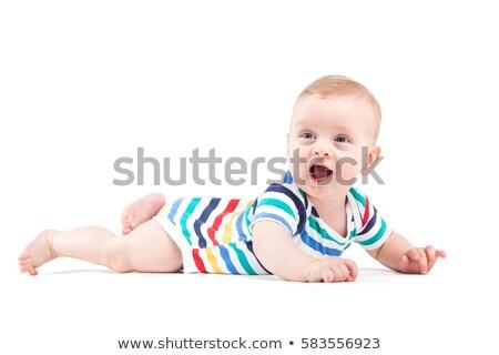 cute pretty baby boy in white shirt lies on tummy Stock photo © Traimak