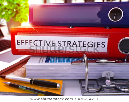Red Ring Binder with Inscription Effective Strategies. Stock photo © tashatuvango