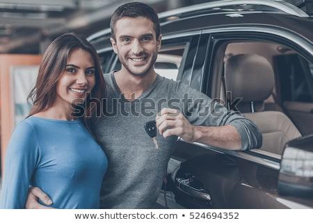 Man holding keys to his new car. Stock photo © RAStudio