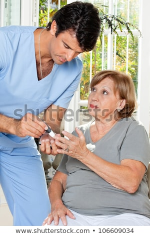 Person Checking Sugar Level With Glucometer Stock photo © AndreyPopov