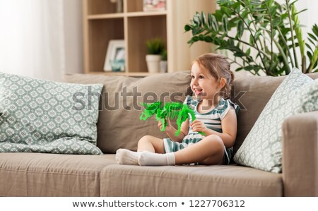 Toddler playing with a dinosaur skeleton Stock photo © IS2