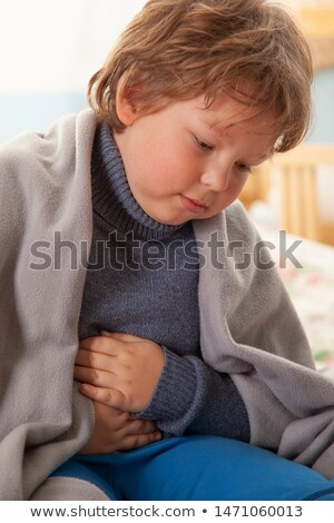 Asian child holding his stomach Stock photo © szefei