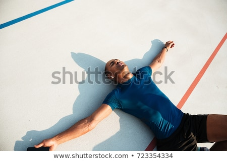 Portré kimerült sportoló zenét hallgat fülhallgató pihen Stock fotó © deandrobot