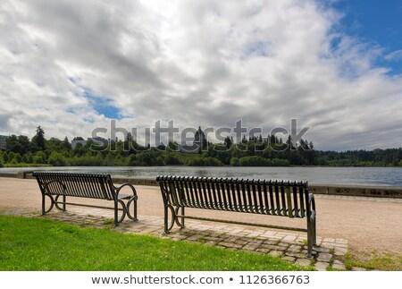 Park Bench along Capitol Lake in Olympia Washington Stock photo © davidgn