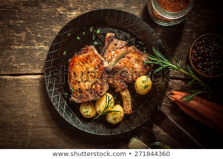 Rustico pan carne di maiale cotoletta Foto d'archivio © zkruger