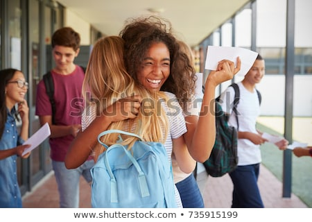 happy students hugging at school Stock photo © dolgachov