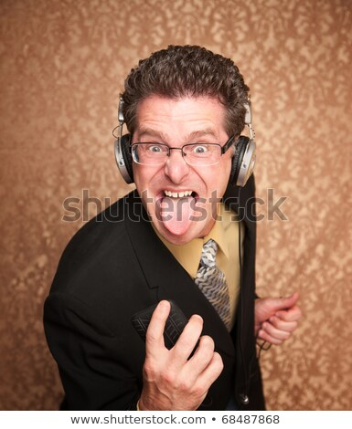 Stock photo: Brown high neck Middle aged men_pop music