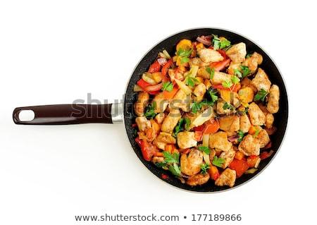 prepares vegetables and chicken in frying pan stock photo © georgemuresan