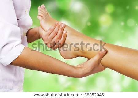 therapist massaging womans feet stock photo © andreypopov