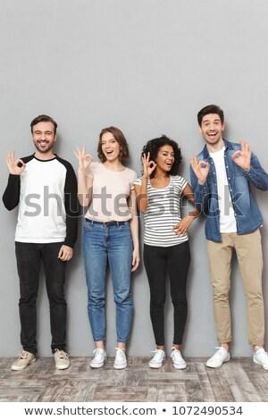 Podniecony grupy znajomych w porządku gest Zdjęcia stock © deandrobot