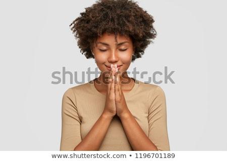 Plein d'espoir jeunes belle femme posant isolé image Photo stock © deandrobot