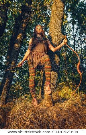Primitive woman holding a bow. Amazon woman Stock photo © artfotodima