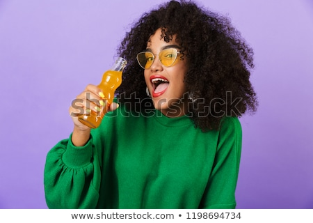 Amazing pretty african woman isolated over violet background drinking soda. Stock photo © deandrobot