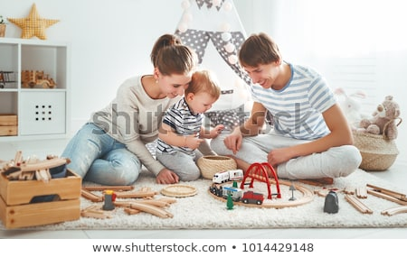boys playing toy blocks in kids tent at home stock photo © dolgachov