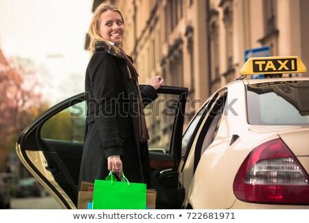 Kadın dışarı taksi araba Stok fotoğraf © Kzenon