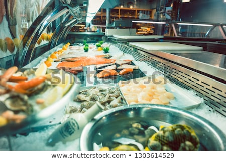 Fresh raw salmon fillet in the freezer of a modern restaurant Stock photo © Kzenon