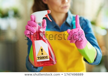 Sunny concept with housekeeper and orange gloves Stock photo © ra2studio